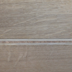 Стык компенсатора между ламинатом и плиткой