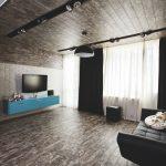 Квартира с использованием ламината на стене и на полу